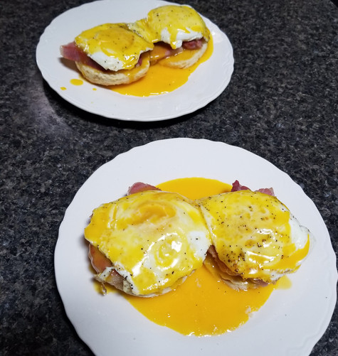 Eggs Benedict is Ronnie's favorite breakfast. I made this from scratch. These English muffins made with organic flour, home-cured Berkshire ham, and fresh farm eggs with a little American cheddar cheese.