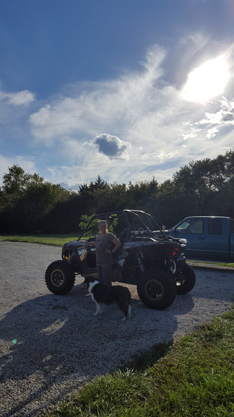 We purchased a Rock Climber Edition RZR. The lower gear allowed for smoother movements up and over terrain. We didn't keep it very long. I could only ride for short periods, even with the best harness available. My back couldn't handle the bouncing, and the noise was too much for me.