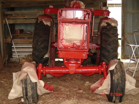 Ronnie and I alternated time in the barn for weeks to paint the International 666 beast. I'd tape all morning, and he would paint in the afternoon. We had to tip-toe around to keep from kicking up dust.  The tractor frame isn't twisted; it wasn't parked level in the barn. We had to tuck it back in a corner to keep it out of the dusty Kansas wind while the paint dried.
