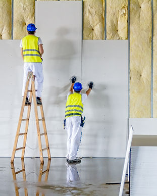 Workers are assembly gypsum wall. Plaste