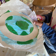 Cutting out our Earth Day window hanger