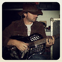 Wisconsin singer and songwriter tom Thiel with a resonator guitar