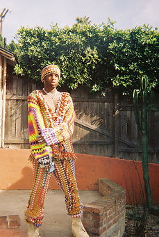 Ty Senoj wearing Custom Remark By Lauren crochet blanket set in LA.