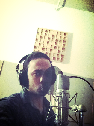"M.Class Dias tracking vocals for his song ""Field of Life""."