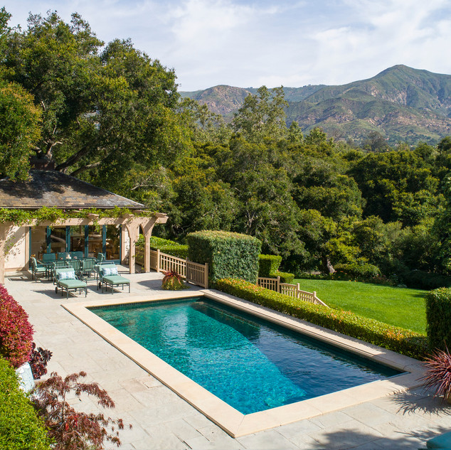 Large pool and pool cabana overlooking the peaceful oak forest