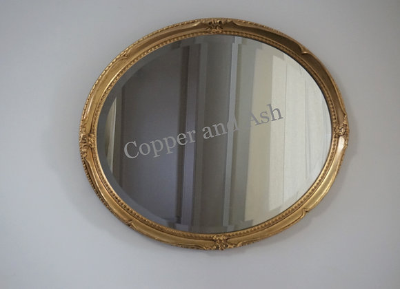 Vintage oval bevelled mirror with gilt frame