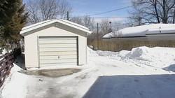 Concrete driveway to car garage