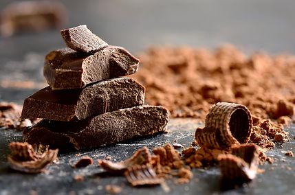 Dark chocolate stack, chips and powder.j