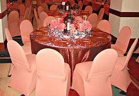 Cheyenne wedding in Wyoming fall glamour in this autumn wedding reception with shalimar tablecloths and spandex chair covers.