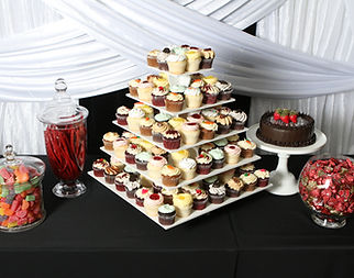 Towers of sweet treats and jars of goodies! White wedding drape. Wyoming wedding