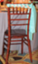 Mahogany Chiavari chair with a limpet shell chair shash accented with a peach echo ribbon. Perfect for your wedding rental!