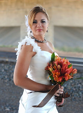 Bold is the new black! Rich orange tone floral includes asiatic lilies and Peruvian lilies. A perfect bouquet for a Nebraska wedding.