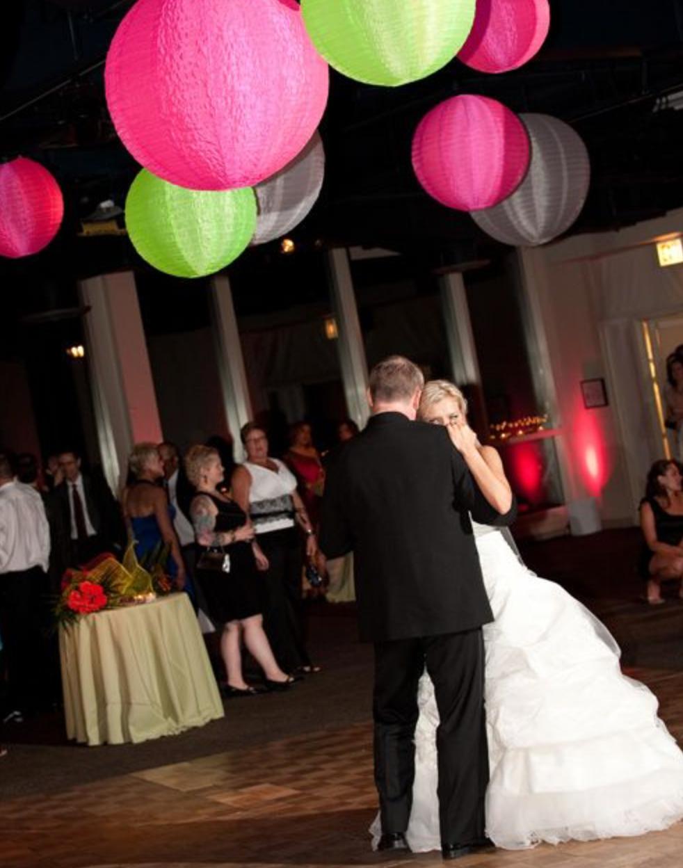 Neon lanterns give an 80's retro vibe to this wedding!