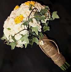 Cream and yellow spray roses accented with ivy and burlap for an elegant rustic design for a Saratoga Wyoming wedding