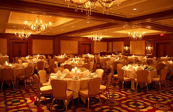 Monocromatic cream tones and warm candlelight add ambiance and romance to this wedding reception in Cheyenne Wyoming.