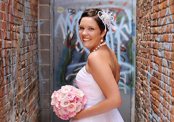Blushing bride with a soft pink rose and crystal bouquet  Jackson Wyoming wedding