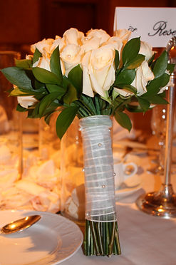 Classic ivory rose bouquet with pearls are a match made in heaven! This Cheyenne wedding was at Little America Hotel.