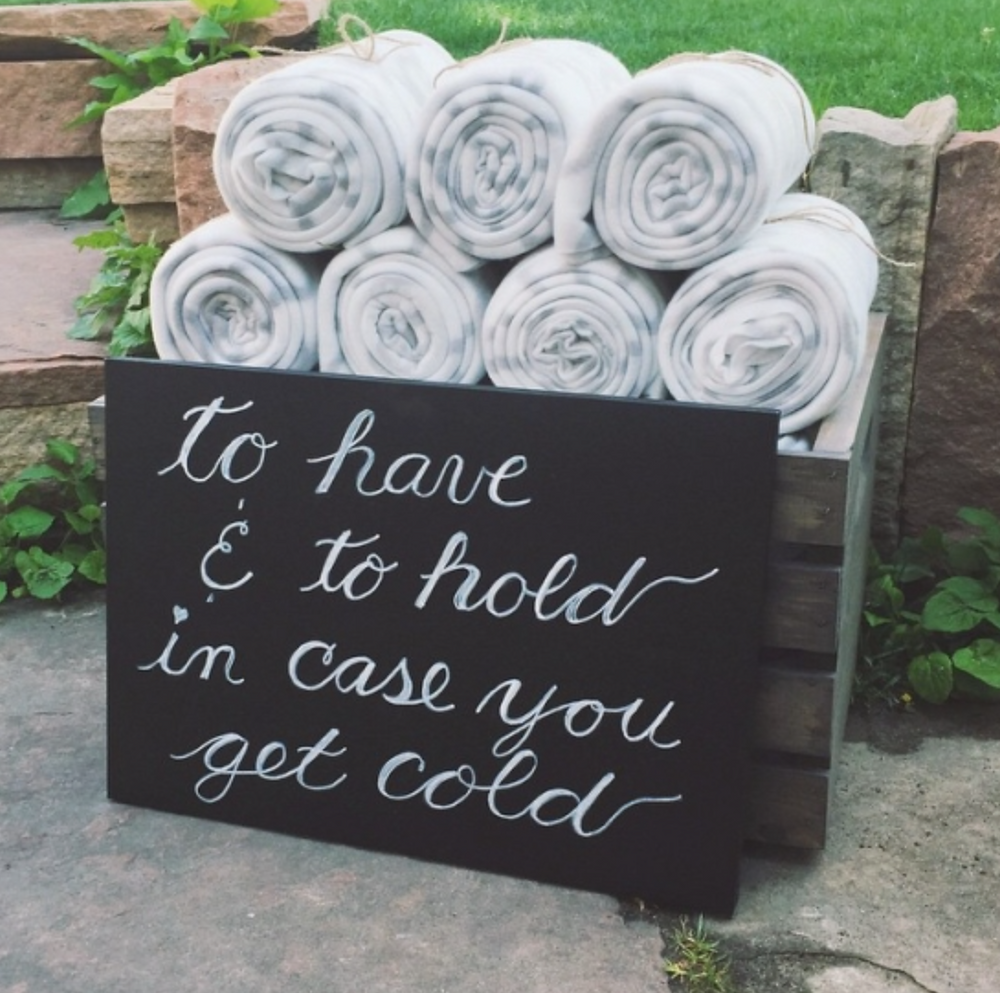 Soft blankets keep guests warm during an outdoor ceremony.