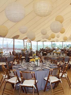 Saratoga Wyoming wedding with cream tone paper lanterns, majestic linen, & floral centerpieces.