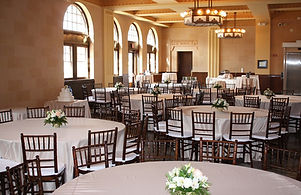 Soft champagne satin linens paired with rich mahogany chiavari chairs; a match made in heaven! Historic Depot museum in Cheyenne Wyoming wedding