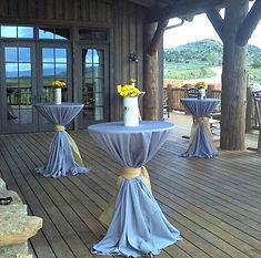 Lilac grey tablecloth with a burlap tie and a centerpiece of buttercup spray roses. This Saratoga wedding at Brush Creek Ranch in Wyoming