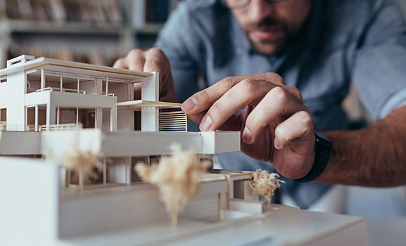 Close up of male architect hands making
