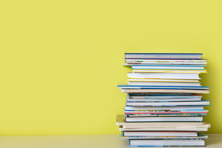 Children's books lie on a bookshelf..jpg