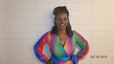 rainbow jumper headshot.jpg
