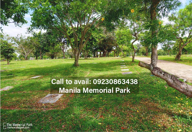 Memorial park is a beautifully landscaped area with an open space surrounded by trees, and flowerbeds.