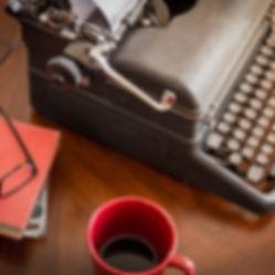 black retro typewriter sitting on wooden