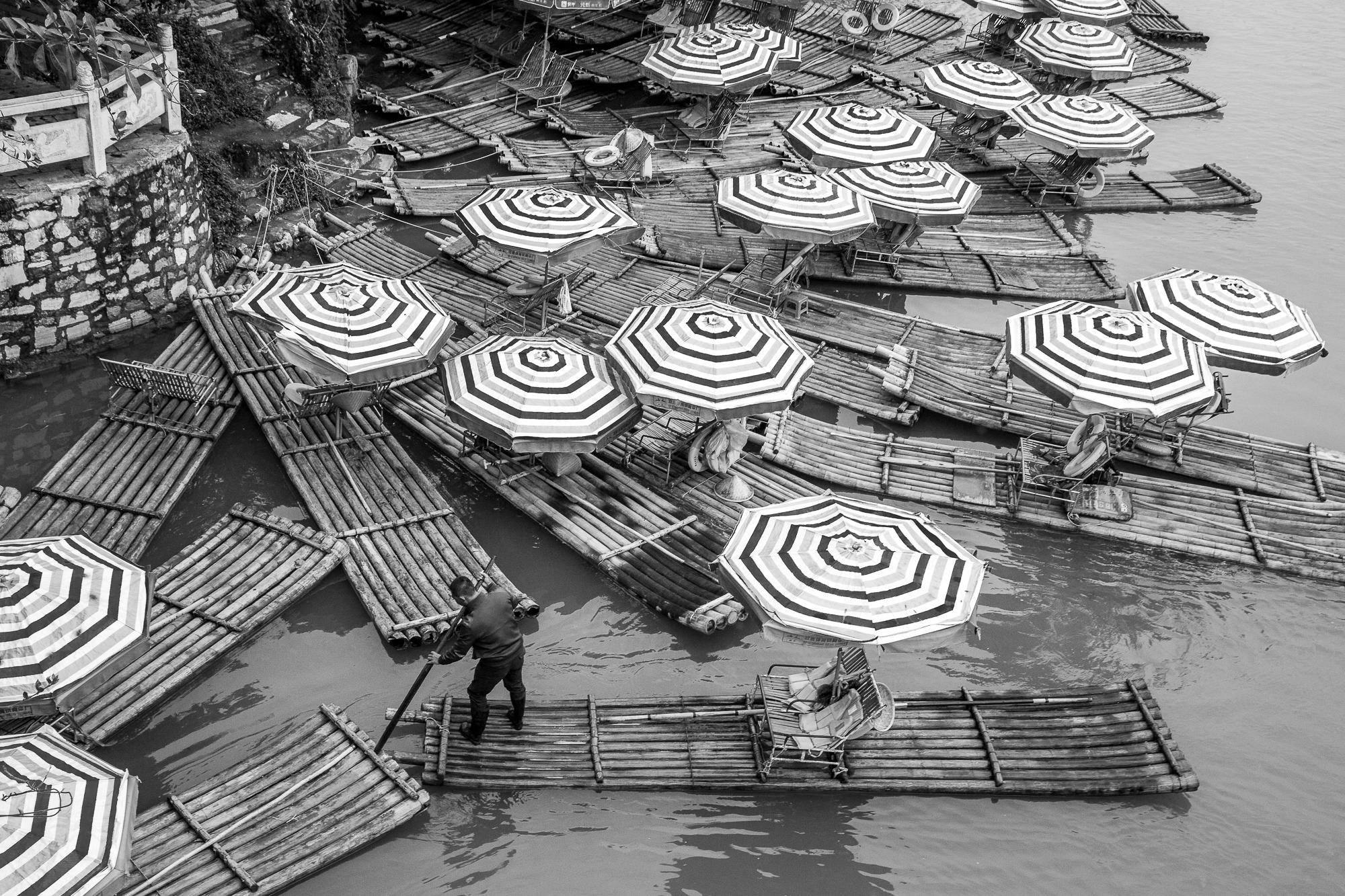 Li River rafts raftman bw