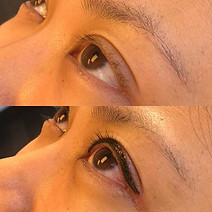 Medium thickness upper eyeliner with small wing.
