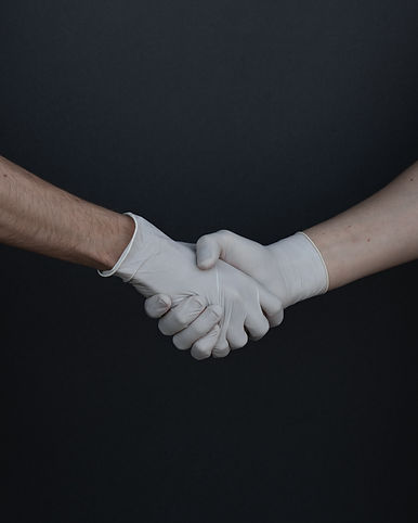 people-shaking-hands-in-latex-gloves-395