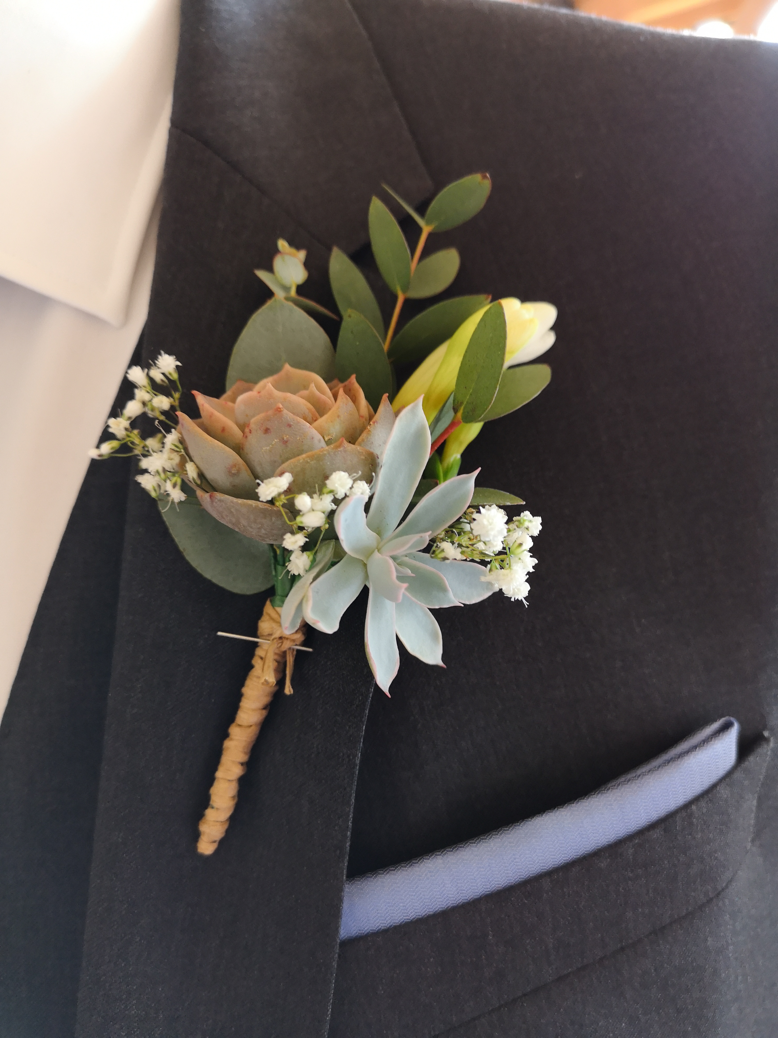 buttonhole succulent with love and roses