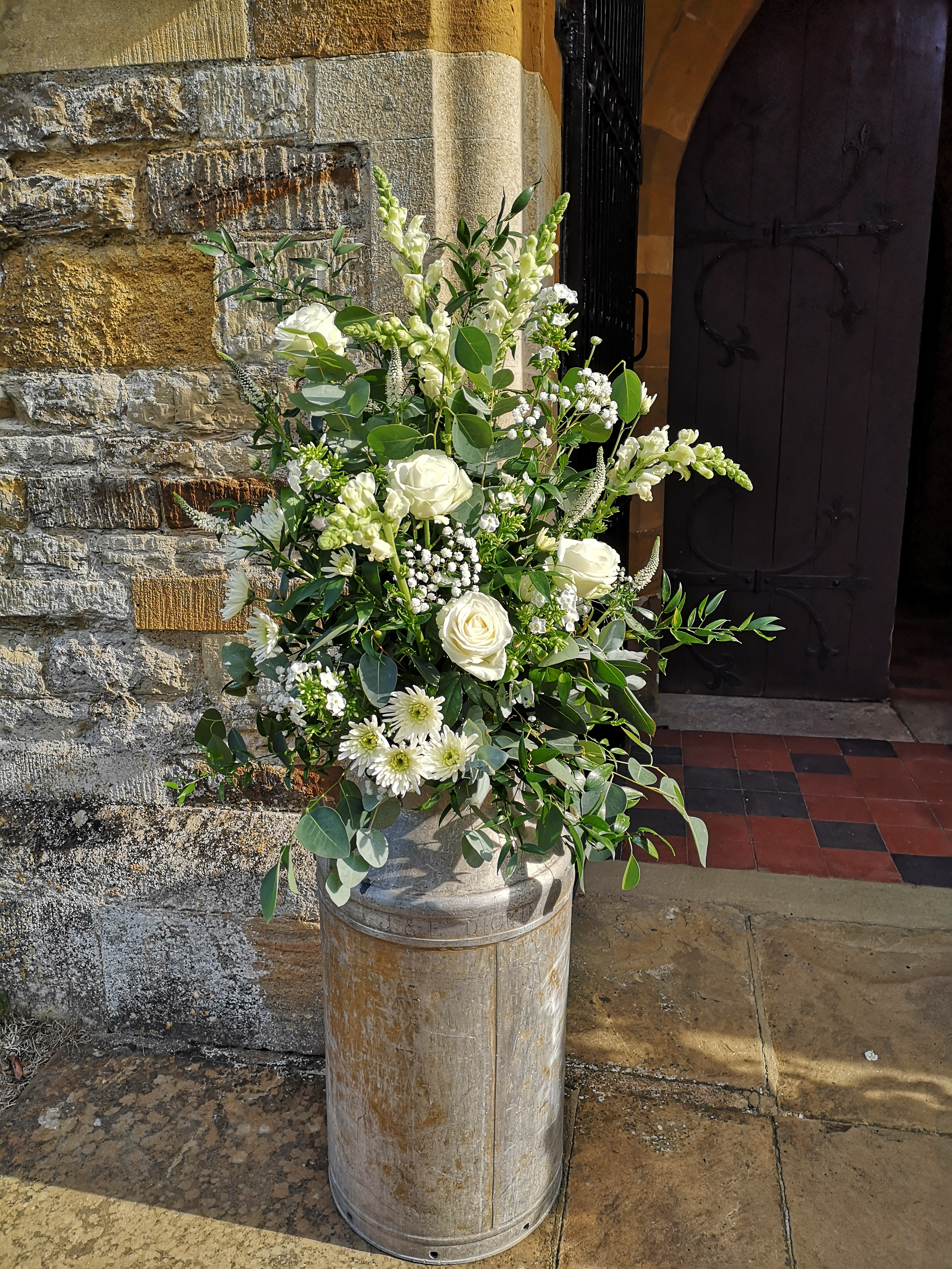 church flowers milk churns rustic weddin