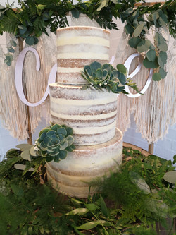 wedding cake flowers succulents with lov