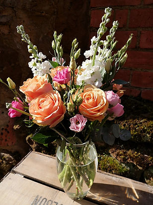 Handtied bouquet in vase.jpg