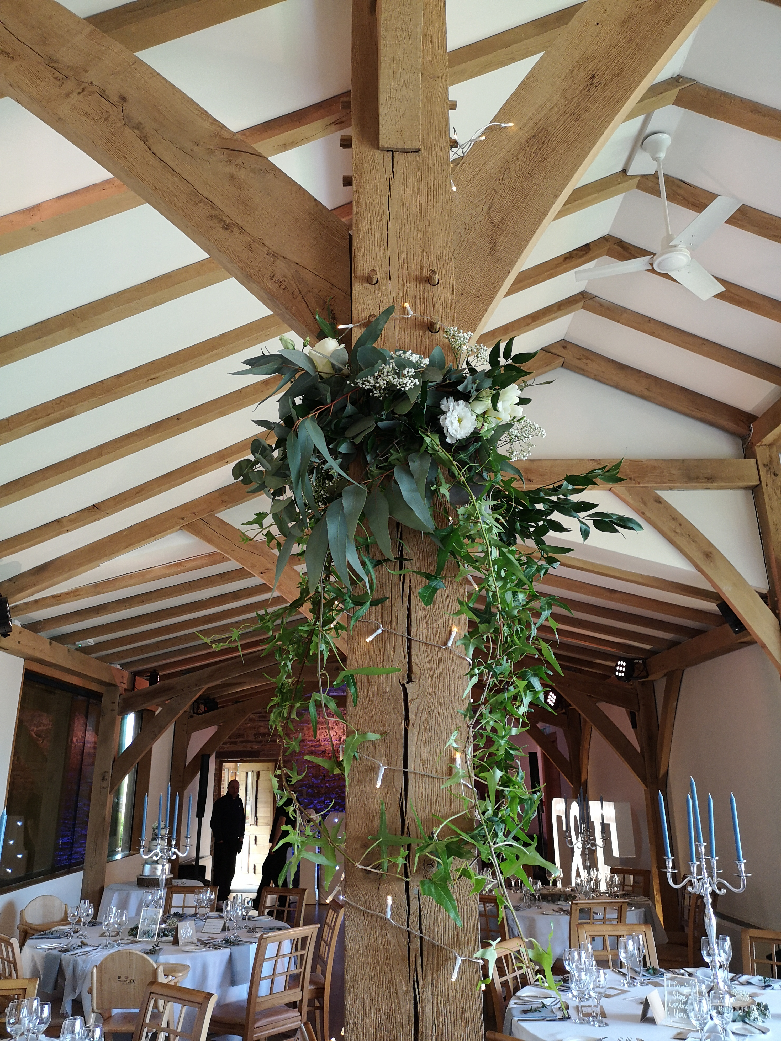 reception room barn decor rustic flowers