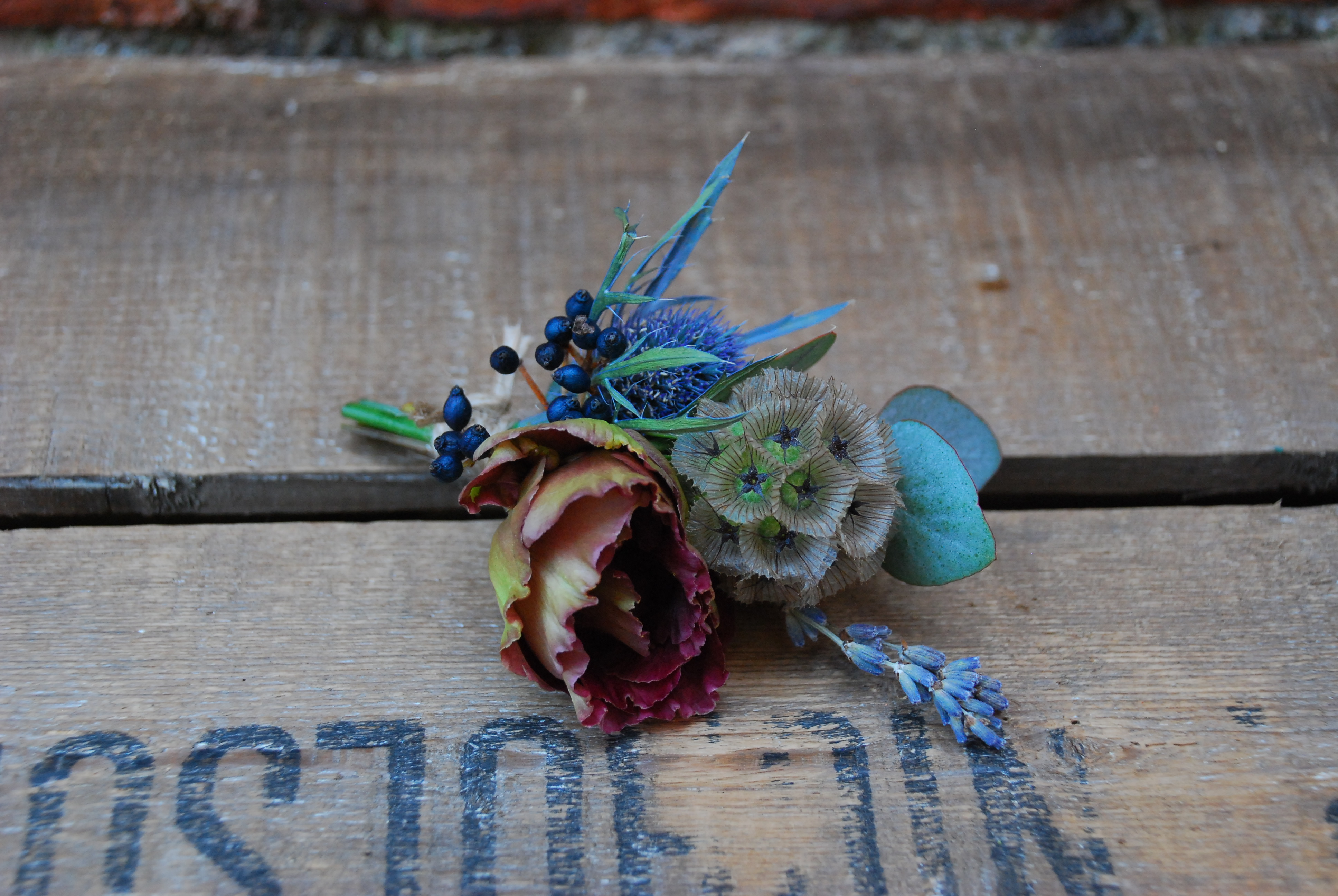 Buttonhole rustic with love and roses