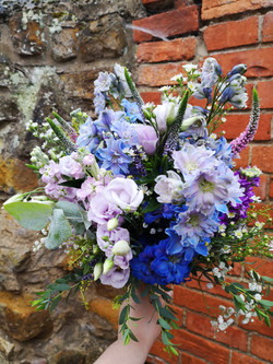 bridal bouquet blue lavender purple rust