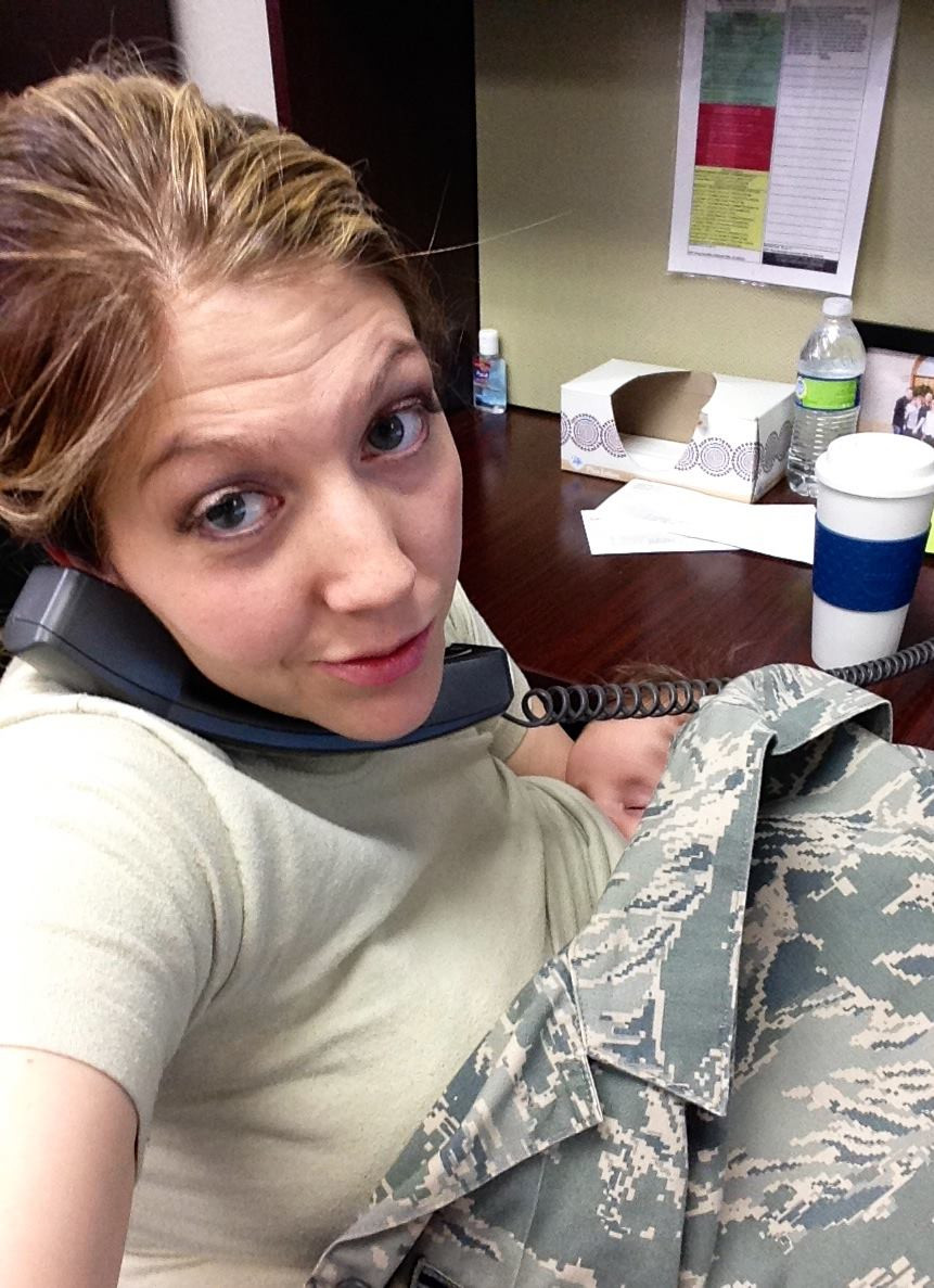 Air Force NCO breastfeeds her child at work after child care was cancelled.  Photo courtesy of the mother.