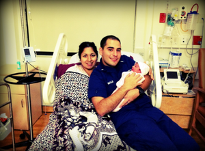 Maria and her husband with newborn baby