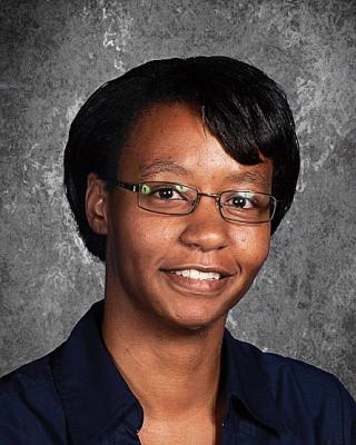 head shot of a professional woman wearing glasses