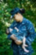 U.S. Navy servicemember breastfeeds her child