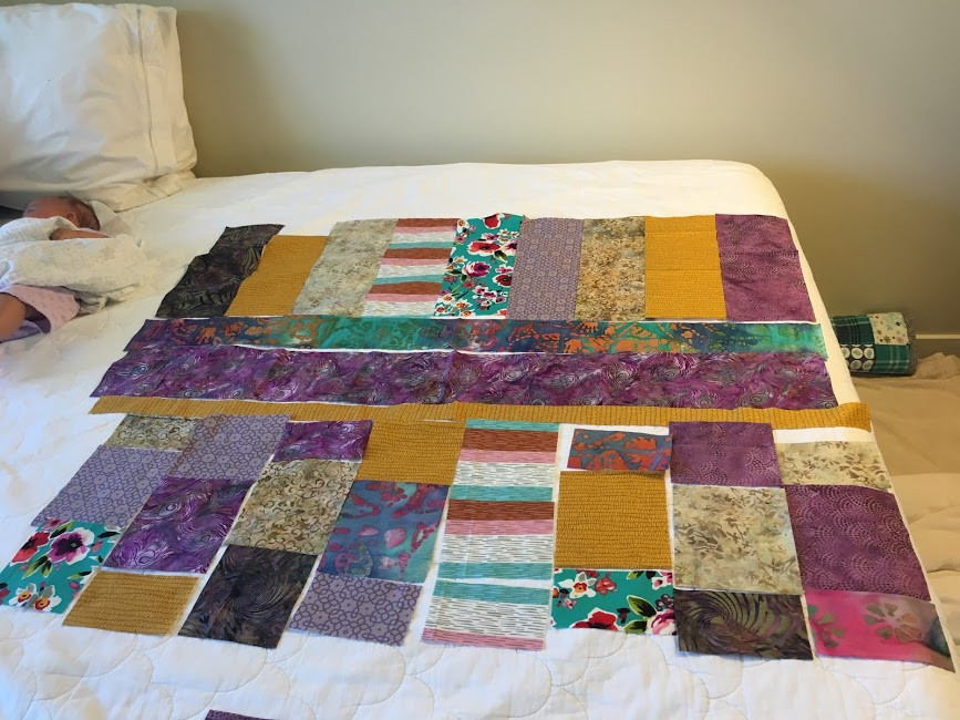 putting the pieces of a quilt together