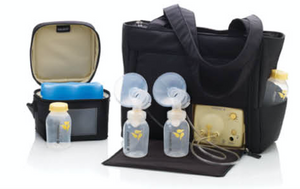 photo of a breastpump in a carrying bag, connected to storage bottles with a cooler next to it