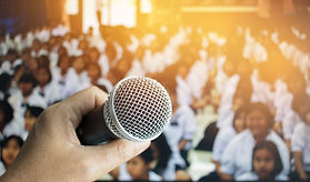teacher hand holding microphone for spee