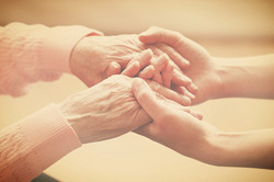 Helping hands, care for the elderly concept_edited