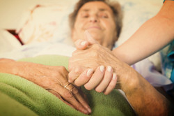 Caring Nurse Holding Hands_edited