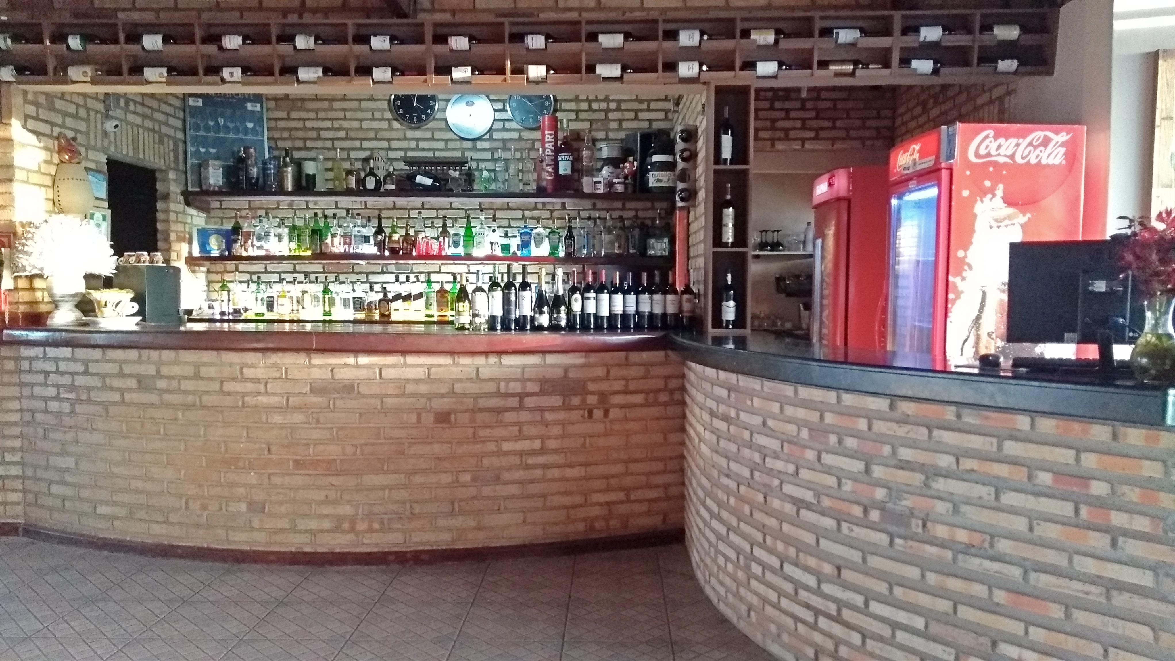 Recepção pousada e restaurante.